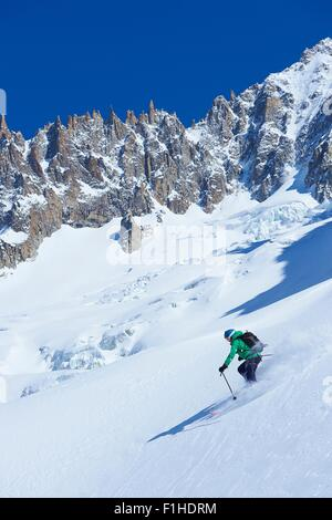 Male skier skiing steep downhill on Mont Blanc massif, Graian Alps, France - Stock Photo