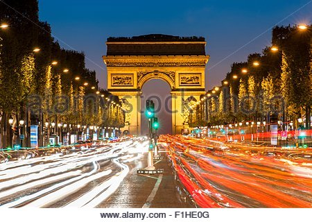 View of the traffic in front of Arc de Triomphe at night, Paris, France - Stock Photo