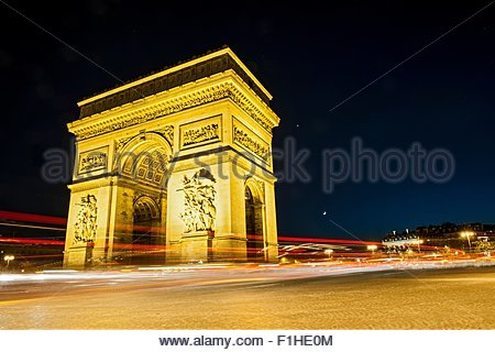 View of the Arc de Triomphe and traffic at night, Paris, France - Stock Photo