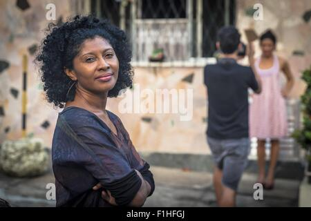 Portrait of fashion shoot assistant smiling and looking at camera - Stock Photo