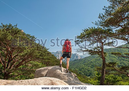 Hiker enjoying the view on the way to Mt. Ulsanbawi at Seoraksan national park, Gangwon, South Korea - Stock Photo