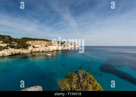 View of Cala Macarella and sailboat, Menorca, Spain - Stock Photo