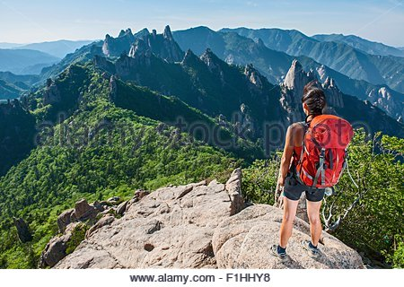 Female hiker enjoying the view from ridge at Seoraksan National park, Gangwon, South Korea - Stock Photo