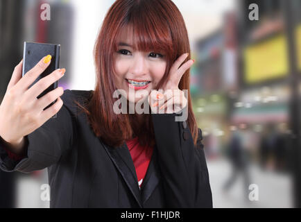 closeup image of beautiful asian woman portrait in the city - Stock Photo