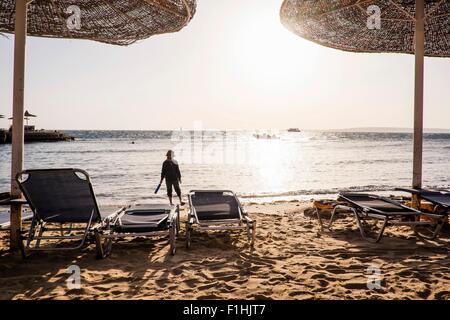 Young boy walking along beach, Hurgada, Red Sea, Egypt - Stock Photo