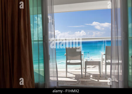 Balcony with plastic bottle of water on wicker table for Balcony overlooking ocean