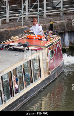 Camden Town , Regents Canal , London Waterbus Perseus turning steering into market berth stop barge longboat pilot - Stock Photo