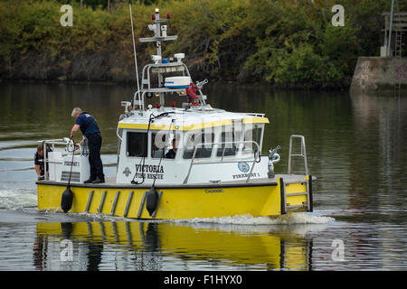 City of Victoria fireboat on way to scene of capsized barge with crushed automobiles in Gorge Waterway-Victoria, - Stock Photo