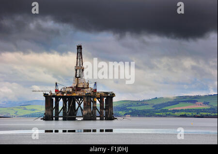 Oil rig / oil drilling platform waiting to be repaired in Cromarty Firth near Invergordon, Ross and Cromarty, Scotland, - Stock Photo