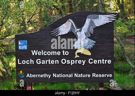 Welcoming board at entrance of the RSPB Loch Garten Osprey Centre in the Cairngorms National Park, Scotland, UK - Stock Photo