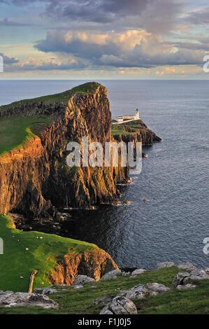 Neist Point Lighthouse at sunset on the Isle of Skye, Inner Hebrides, Scotland, UK - Stock Photo