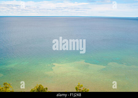 looking down at a clear clean lake on a sunny summer day - Stock Photo
