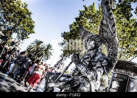 Street Performer imitating statue, Barcelona, Spain, La Rambla - Stock Photo