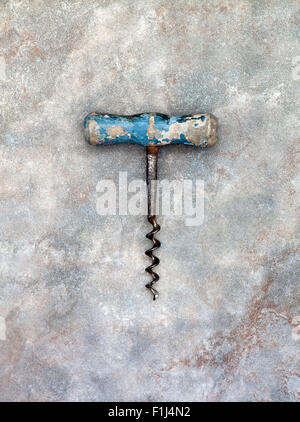Old or Vintage Corkscrew with Blue wooden handle - Stock Photo