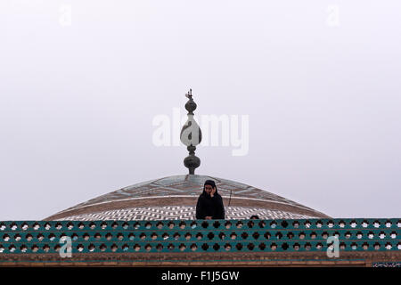 Woman in the dome of Jame Mosque, Yazd, Iran - Stock Photo