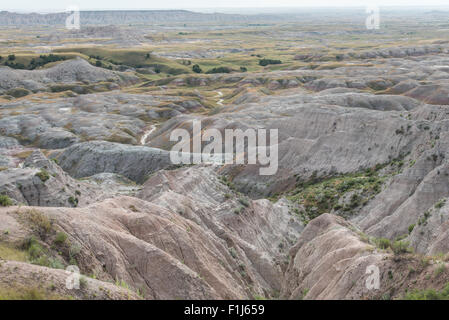 The rolling eroded rock and soil formations at Badlands National Park, South Dakota. - Stock Photo