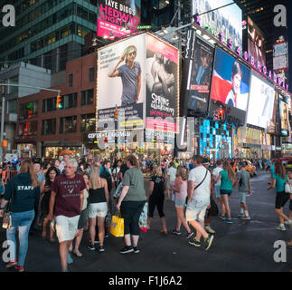 A billboard in Times Square in New York pokes fun at the push to raise the minimum wage to $15 per hour for fast - Stock Photo