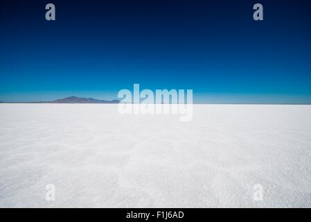 Salt Flats in Utah. Salt Flats Landscape. Dark Blue Sky and Snow White Salt Soil. Boneville near Salt Lake City, - Stock Photo
