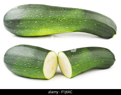 Fresh courgette cut in half isolated on white background. - Stock Photo