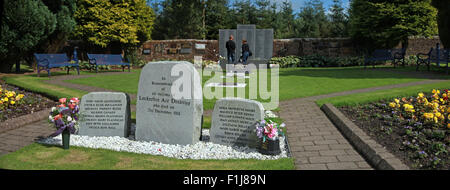 Wide shot with visitors at the Lockerbie PA103 memorial, Scotland - Stock Photo