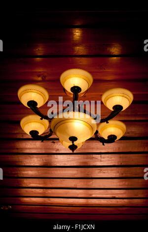 Vintage ceiling lamp fixture in dark hallway - Stock Photo