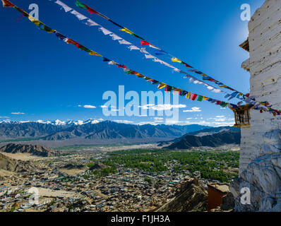 The monastery Namgyal Tsemo Gompa and Tsemo Fort, surrounded by Tibetan prayer flags, high above the old part of town on a