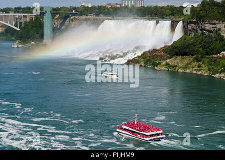 Hornblower and Maid-of-the-Mist sightseeing cruises on Niagara River in  Niagara Falls.  American Falls is shown. - Stock Photo