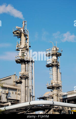 Chimneys of industrial plant - Stock Photo