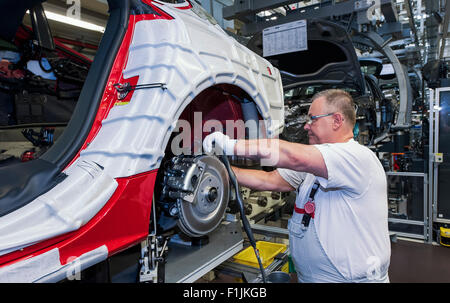 Audi technician assembling an Audi A6 on the production line, Audi factory in Neckarsulm, Baden-Württemberg, Germany - Stock Photo