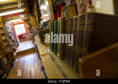 A shelf of antique books at Wenlock Books in Much Wenlock, Shropshire, England. - Stock Photo