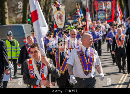 St Georges Day Orange parade in City of London being escorted by the Metropolitan Police,England. - Stock Photo