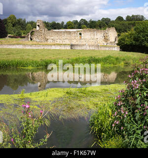 The historic remains of Kirkham Priory reflected in the River Derwent, North Yorkshire, England, UK - Stock Photo