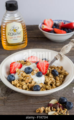 Home-made granola with berries. - Stock Photo