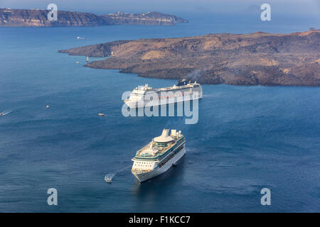 Cruise ships near Santorini, one of the Cyclades islands in Aegean Sea, Greece. - Stock Photo