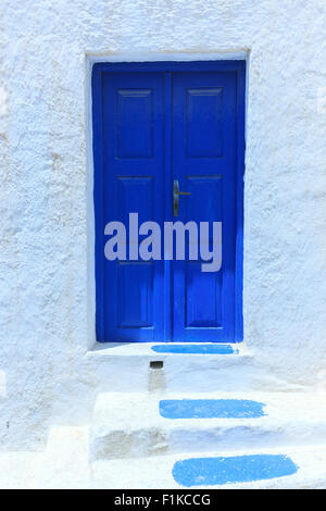 A blue frontdooron Santorini one of  Cyclades islands in Aegean Sea, Greece. - Stock Photo