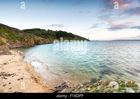 St Anthony's Head on the Roseland Peninsula in Cornwall with the lighthouse in the distance - Stock Photo