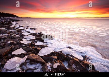 Winter sunset at Nes on the island Jeløy, Oslofjorden, Norway. - Stock Photo