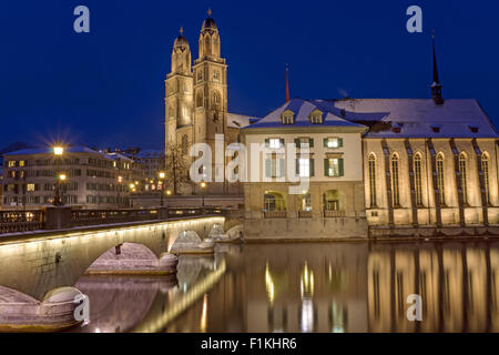 The river and the Minster in Zurich in Winter at night - Stock Photo