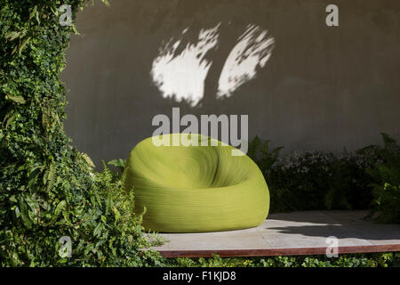 The Macmillan Legacy Garden - contemporary garden shelter with living walls planted with woodland plants, ferns - Stock Photo