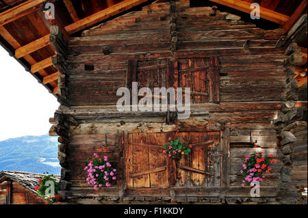Traditional wooden granary / raccard decorated with flowers in Alpine village Grimentz, Valais / Wallis, Swiss Alps, - Stock Photo