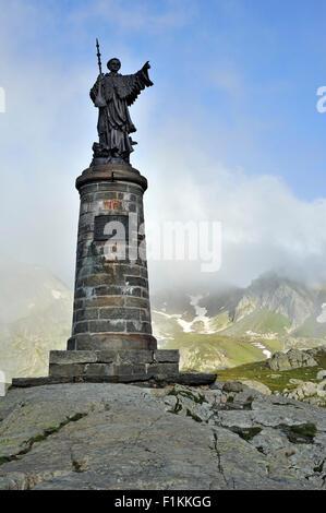 Statue of Saint Bernard at the Great St Bernard Pass / Col du Grand-Saint-Bernard in the Swiss Alps, Switzerland - Stock Photo
