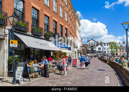 Shops and cafes on Cathedral Yard in the city centre, Exeter, Devon, England, UK - Stock Photo