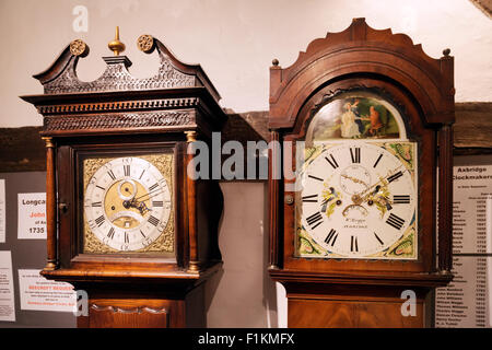 Two Long Case or Grandfather clocks made in Axbridge Somerset in the 18th Century; by John Bilbie (lt) and William - Stock Photo