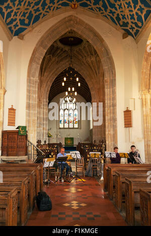 Musicians playing inside the 15th Century Church of St John the Baptist, Axbridge Somerset UK - Stock Photo