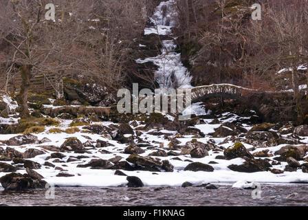 Allt Da-ghob waterfall with a medieval bridge in Glen Lyon, Scotland - Stock Photo