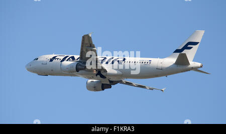 Finnair Airbus a320 OH-LXI taking off from London Heathrow Airport LHR - Stock Photo