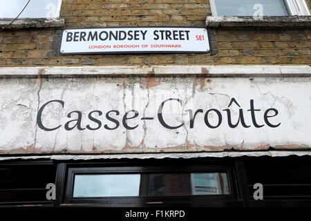 Casse-Croute French restaurant cafe and Bermondsey Street sign signs in the Borough of Southwark, South London UK - Stock Photo