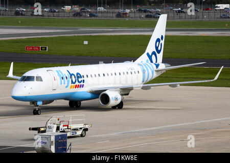 FlyBe Embraer 175 taxis onto stand at Manchester airport. - Stock Photo