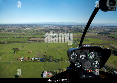 Airfield Road and farmland seen from Robinson R44 helicopter, Ardmore, South Auckland, North Island, New Zealand - Stock Photo