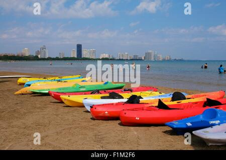Chicago, USA, 3rd September 2015. Colorful rental kayaks line Montrose Beach at Lake Michigan on this steamy early - Stock Photo